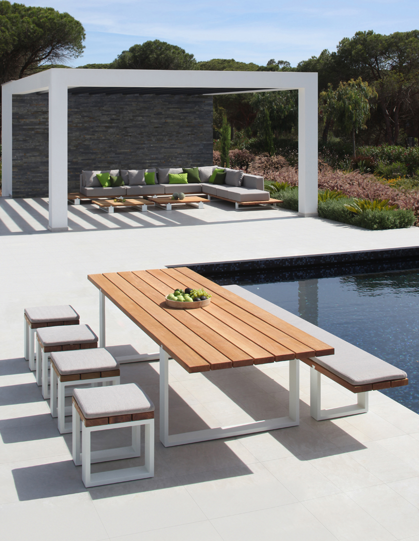 Vigor is a table suitable for outdoor use with solid wooden top. Sturdy and elegant, it's designed for your life outdoors while offering plenty of space.