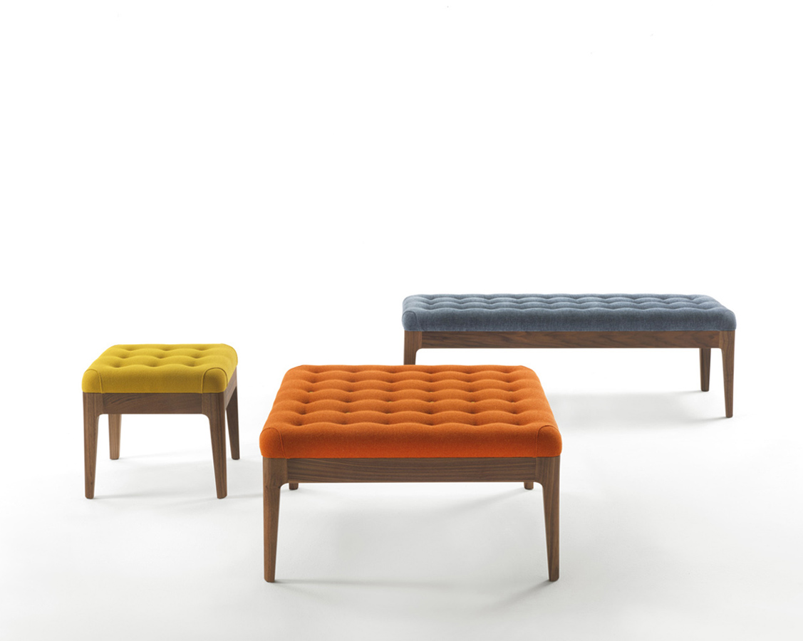 Pouf Webby is a series of footstools; all units have a timber frame and tufted seat. This line, designed by Carlo Ballabio, includes a stool, an ottoman and a small bench.