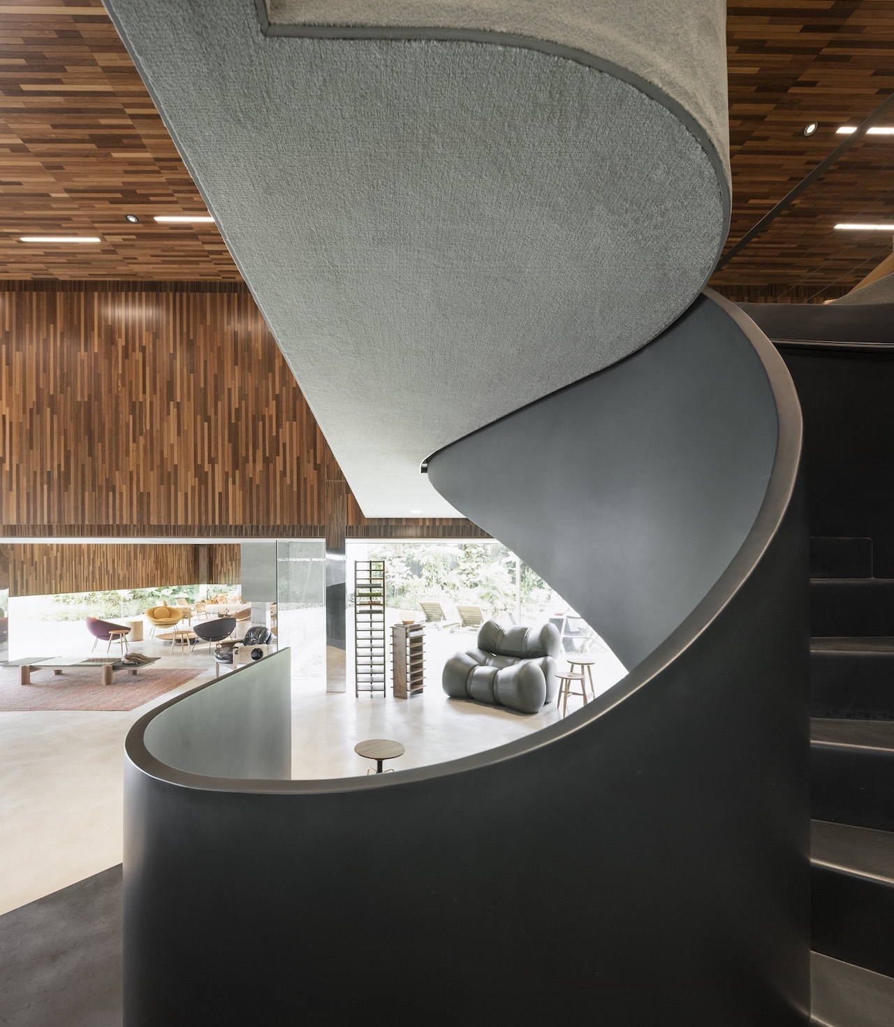 A spectacular spiral staircase leads to the showroom's mezzanine floor.