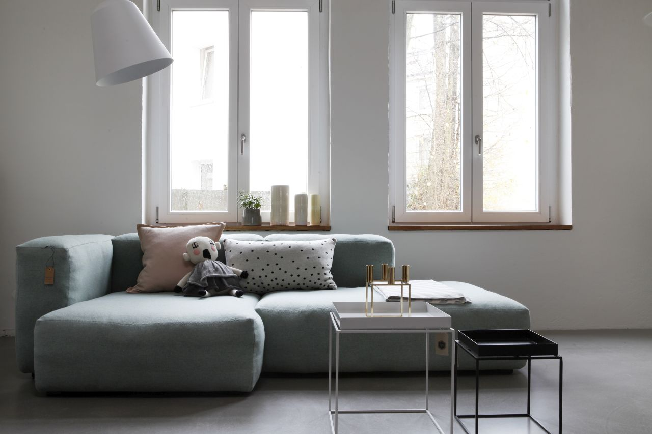 Living room scheme with pale green sofa by Kopio.