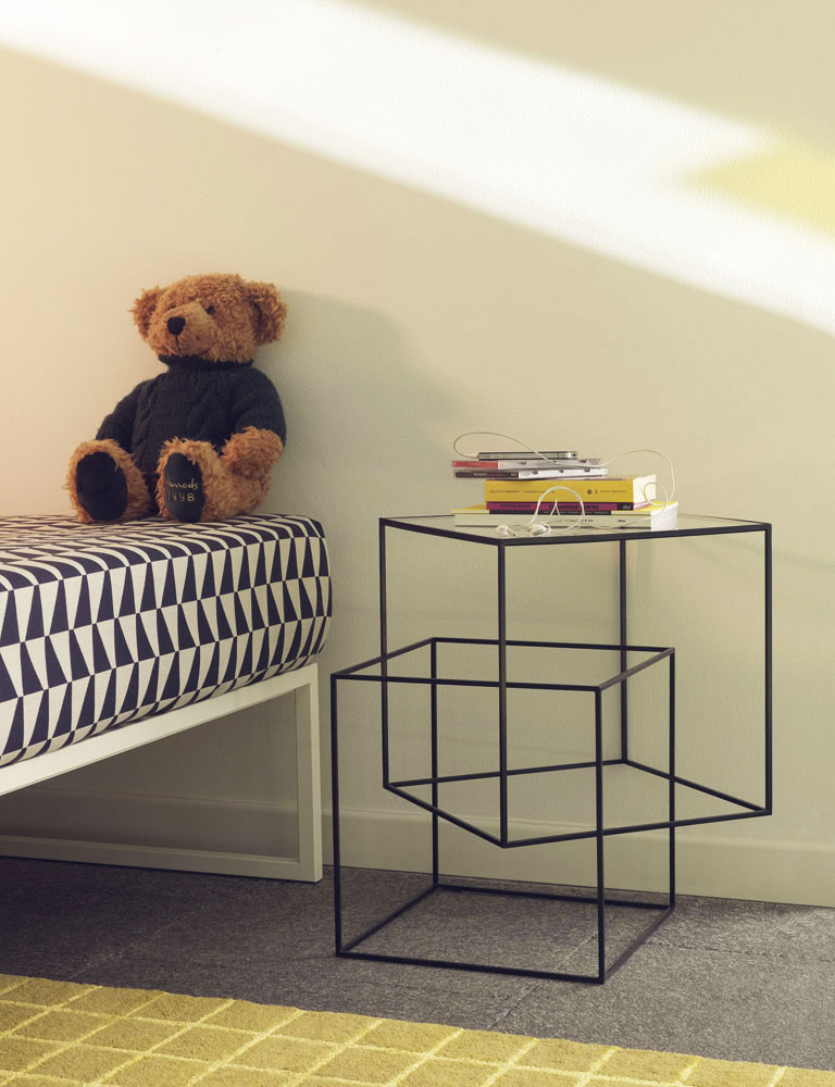 thin black side table by cappellini